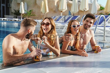 Three excited young women in swimwear taking a selfie Stock photo © deandrobot
