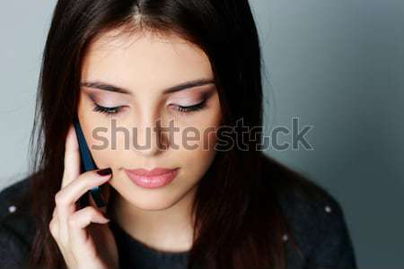 Closeup portrait of a beautiful woman with long brown hair Stock photo © deandrobot