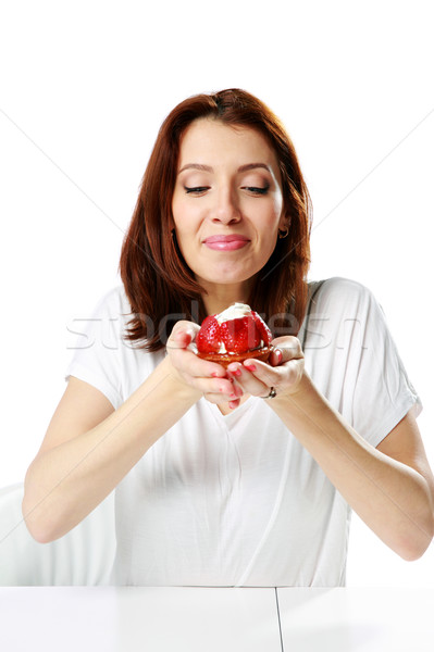 Beautiful woman sitting at the table and holding fresh strawberry cake isolated on a white backgroun Stock photo © deandrobot