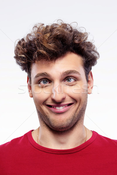 Portrait of a young man with funny expression on his face Stock photo © deandrobot