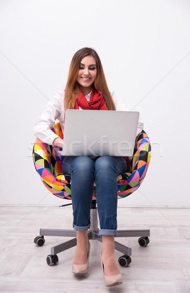 женщину сидят Председатель ноутбука Сток-фото © deandrobot