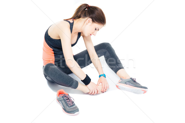 Portrait of a sporty woman with pain on leg Stock photo © deandrobot