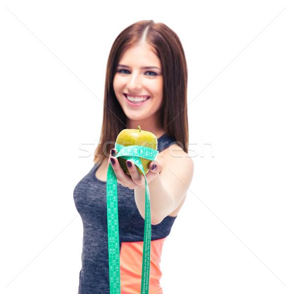 Glimlachend fitness vrouw appel meetlint geïsoleerd witte Stockfoto © deandrobot