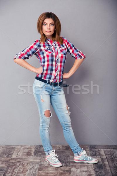 Happy fashion woman standing in studio Stock photo © deandrobot
