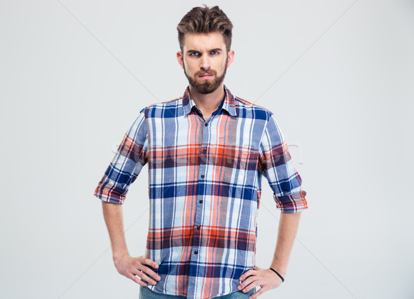 Portrait of a young serious man looking at camera  Stock photo © deandrobot
