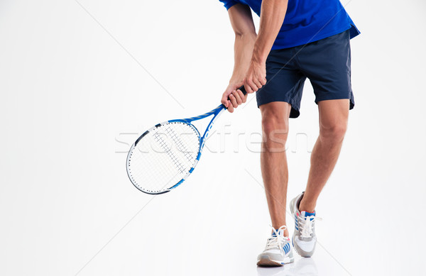 Male legs and tennis racket  Stock photo © deandrobot