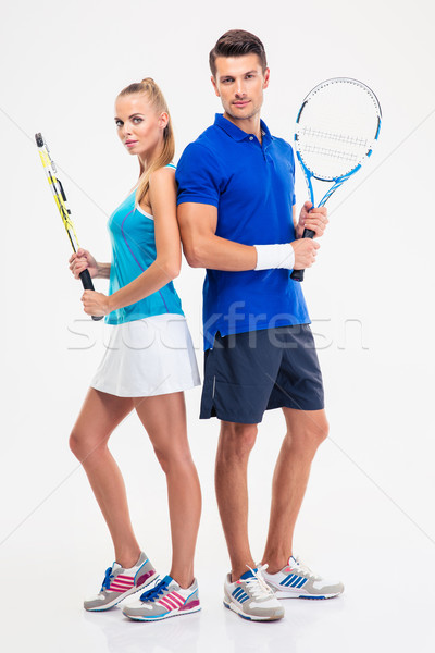 Full length portrait of a two tennis players Stock photo © deandrobot