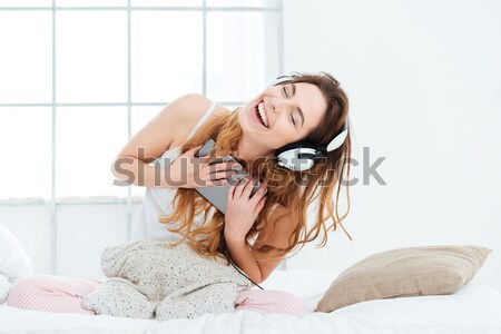 возбужденный заманчивый женщину музыку наушники Сток-фото © deandrobot
