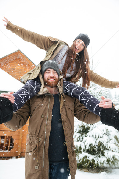 Couple having fun together in snowy weather  Stock photo © deandrobot