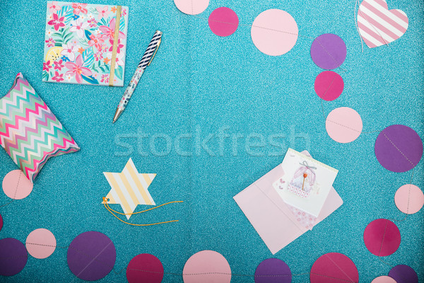 Colorful decorations, notepad, pen and present box on shining  backgound Stock photo © deandrobot