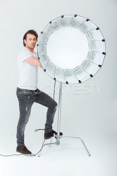 красивый мужчина осветительное оборудование портрет изолированный белый Сток-фото © deandrobot