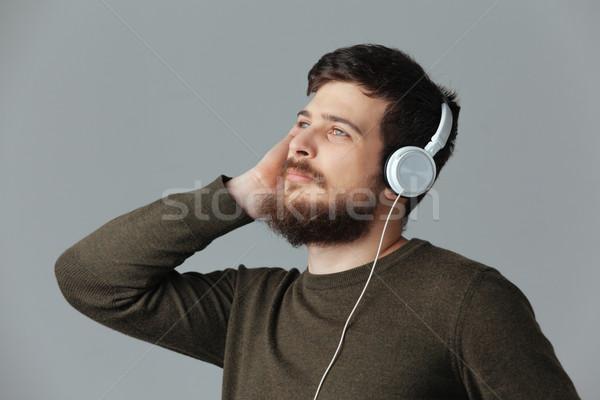 Bel homme écouter musique casque gris main Photo stock © deandrobot