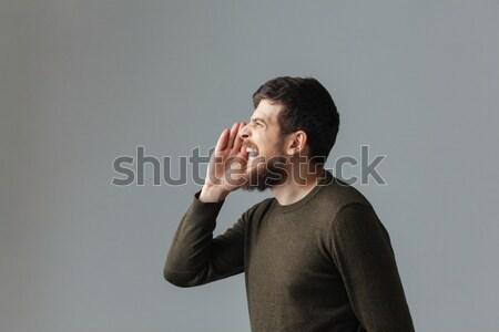 Vue de côté portrait homme gris heureux Photo stock © deandrobot