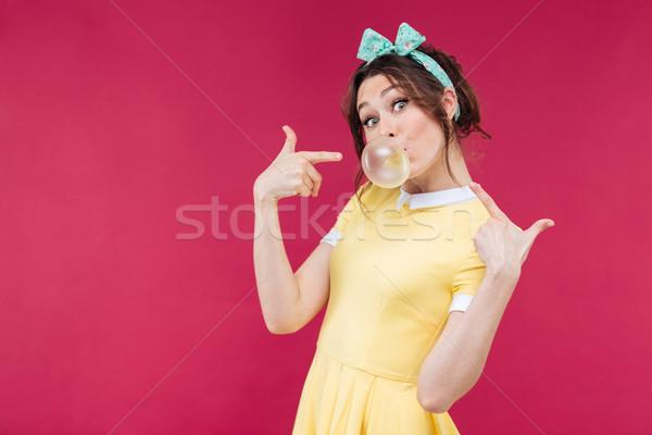 Játékos bájos fiatal nő mutat buborék íny Stock fotó © deandrobot