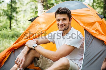 Man tourist with backpack at touristic tent in forest Stock photo © deandrobot
