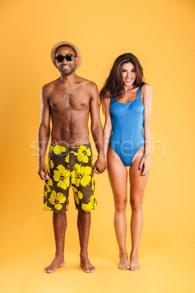 Loving smiling couple in swimwear Stock photo © deandrobot