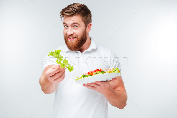 Sonriendo hombre verde lechuga placa Foto stock © deandrobot