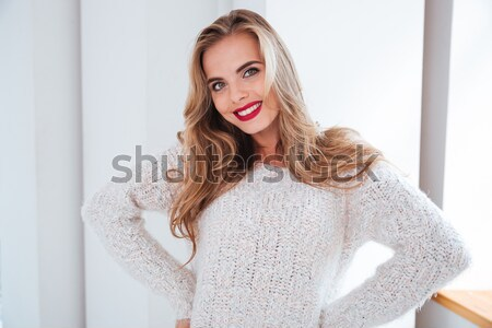 Portrait of a charming girl wearing sweater and red lipstick Stock photo © deandrobot