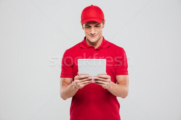 Mensajero tableta estudio frente vista aislado Foto stock © deandrobot
