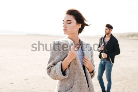 Attractive young couple standing at the seashore in the morning Stock photo © deandrobot