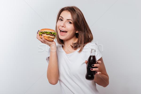 Głodny młoda kobieta jedzenie zdjęcie stałego biały Zdjęcia stock © deandrobot