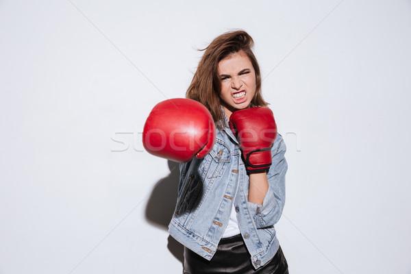 Enojado mujer boxeador aislado blanco foto Foto stock © deandrobot