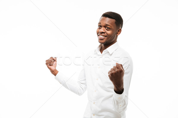 African man make winner gesture. Stock photo © deandrobot