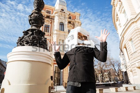 Man in coat with newspaper on face Stock photo © deandrobot