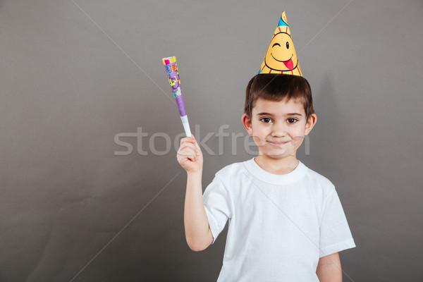 Bonitinho pequeno menino aniversário seis em pé Foto stock © deandrobot