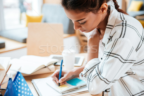 Side view of African Woman in library Stock photo © deandrobot