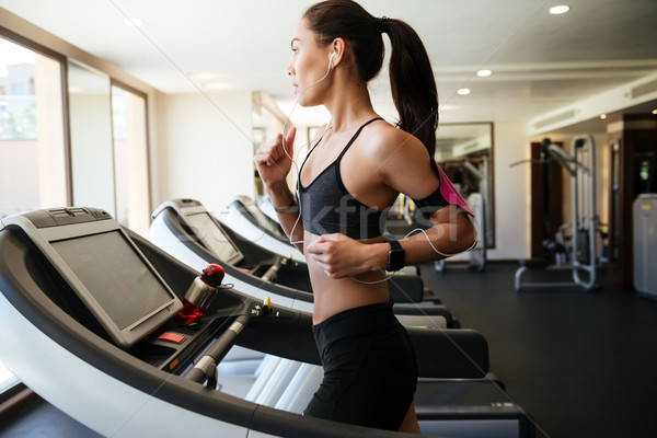 Pretty fitness woman make sport exercises Stock photo © deandrobot