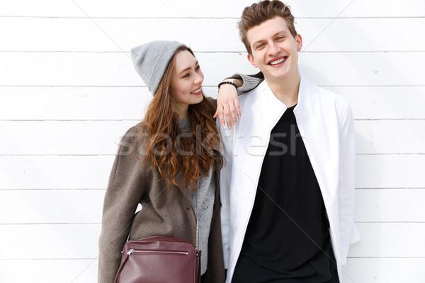Stok fotoğraf: Mutlu · ayakta · birlikte · gülen · beyaz