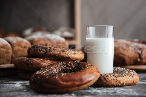 Pastries on dark table and bread on background with milk Stock photo © deandrobot