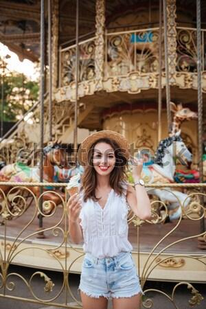 Happy pretty girl eating ice cream Stock photo © deandrobot