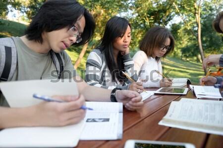 Konsantre grup genç Öğrenciler görüntü Stok fotoğraf © deandrobot