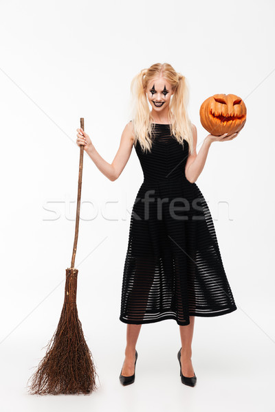Full length portrait of a smiling crazy blonde woman Stock photo © deandrobot