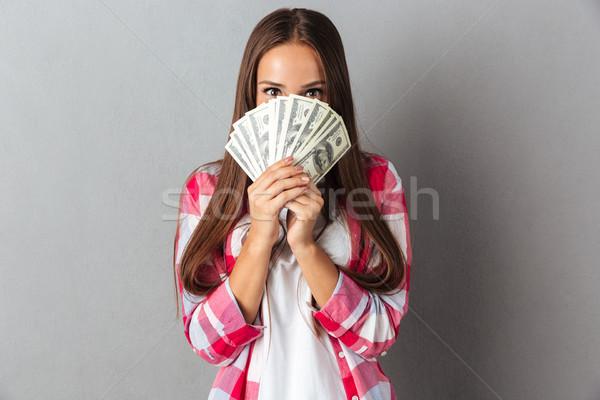 Csinos barna hajú tart papírpénz kezek néz Stock fotó © deandrobot
