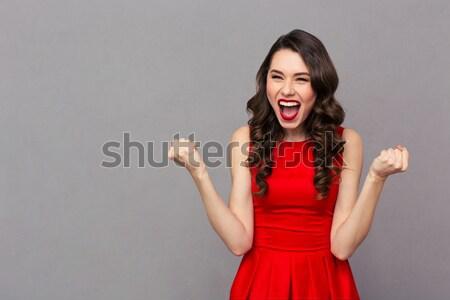 Meglepett fiatal csinos nő piros kötött pulóver Stock fotó © deandrobot