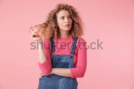 молодые концентрированный Lady играет играх смартфон Сток-фото © deandrobot