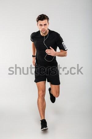 Tam uzunlukta portre ciddi genç atlet kulaklık Stok fotoğraf © deandrobot
