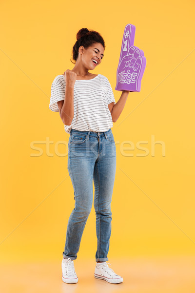 Happy winner lady with fan finger standing isolated Stock photo © deandrobot