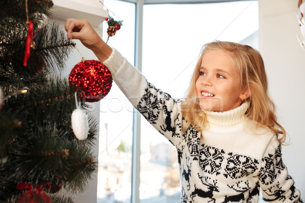 Close-up photo of cheerful little blonde girl in knitted sweater Stock photo © deandrobot