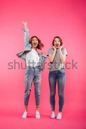 Teljes alakos kép kettő boldog nők néz Stock fotó © deandrobot
