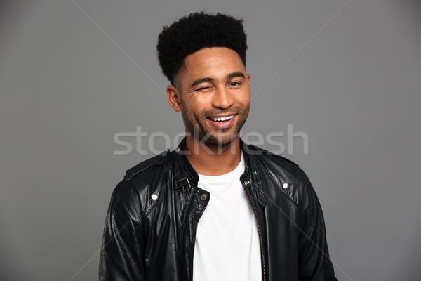 Jungen lächelnd african Mann schwarz Lederjacke Stock foto © deandrobot