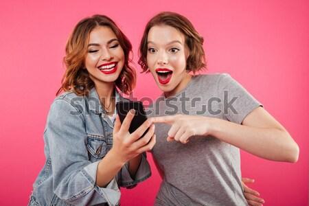Emotional ladies friends blowing kisses. Stock photo © deandrobot
