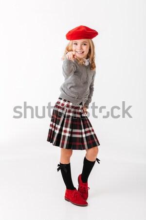 Full length portrait of a happy little schoolgirl Stock photo © deandrobot