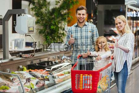 Happy family with child buying food Stock photo © deandrobot