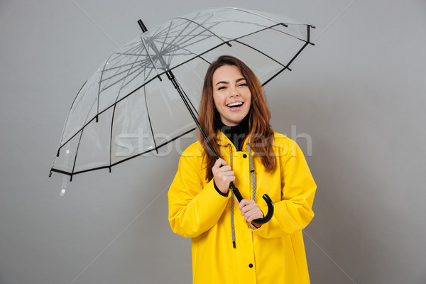 Portré boldog lány esőkabát pózol áll nyitva Stock fotó © deandrobot
