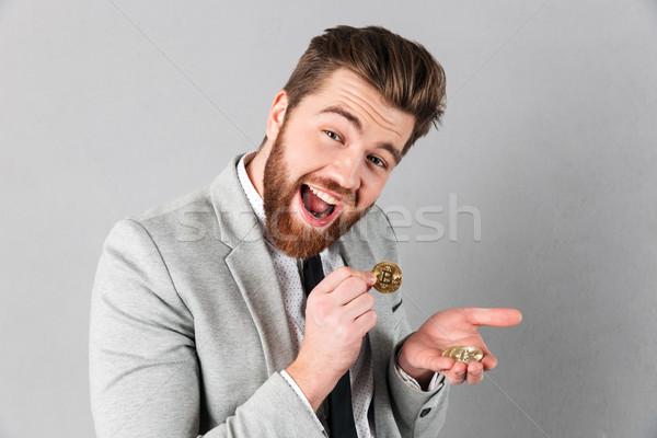 Portrait of a cheerful businessman Stock photo © deandrobot