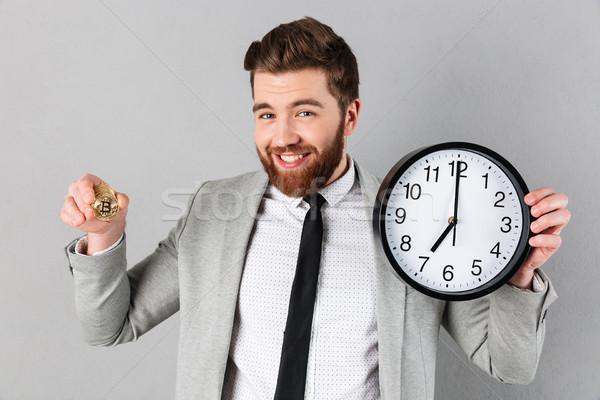 Portrait of a smiling businessman Stock photo © deandrobot